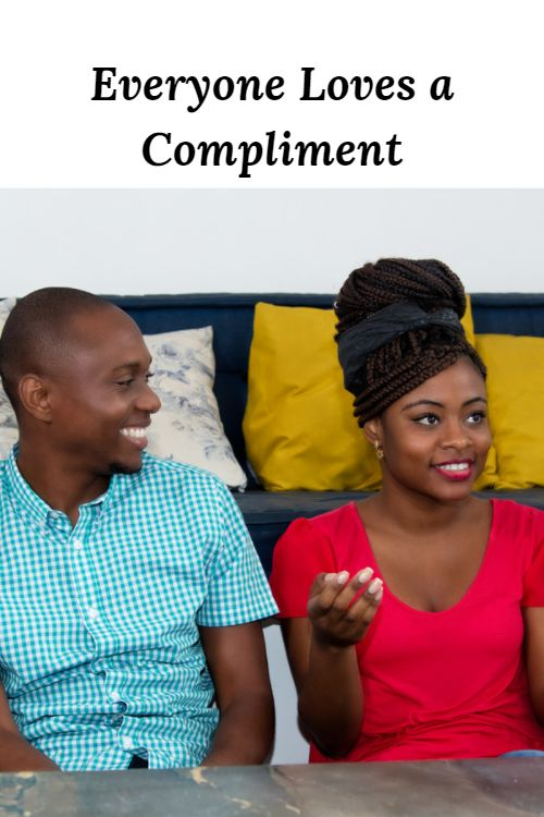 """Happy African American couple and the words """"Everyone Loves a Compliment"""""""