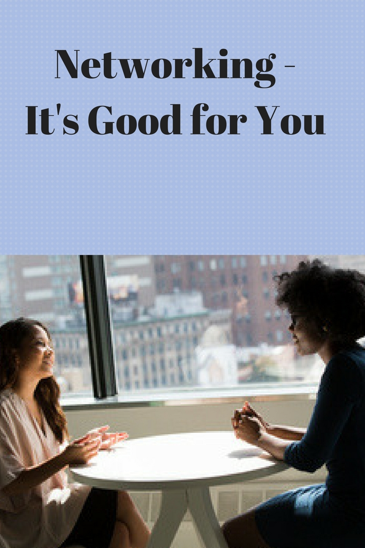 """two women sitting at a table near a window in a high rise building and the words """"networking it's good for you"""""""