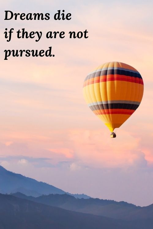 """picture of hot air balloon in the clouds and the words """"Dreams die if they are not pursued."""""""