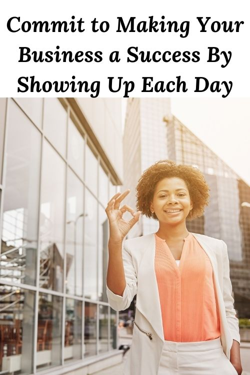 african american woman outside an office building and the words - Commit to Making Your Business a Success By Showing Up Each Day