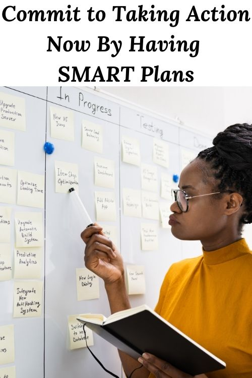 African American woman at a whiteboard with the words Commit to Taking Action Now By Having SMART Plans